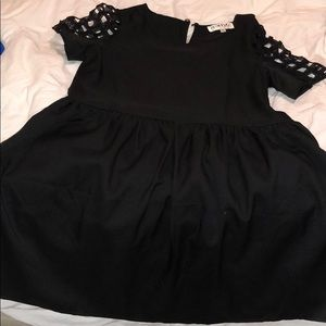 Black saboskirt dress with caged sleeves